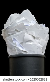 Full wastebasket on the subject of digitization and printing costs