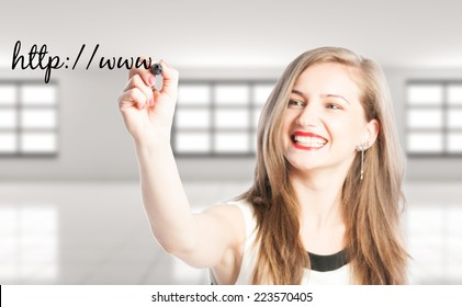 Full website address or URL concept using woman hand writing on screen with a black marker