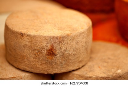 full wheels of local cheese, covered with gofio, local foodstuff made of roasted grains, Gran Canaria, village fiesta in Tenteniguada, Valsequillo municipality