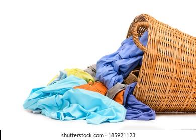 Full wicker laundry basket  isolated on white background