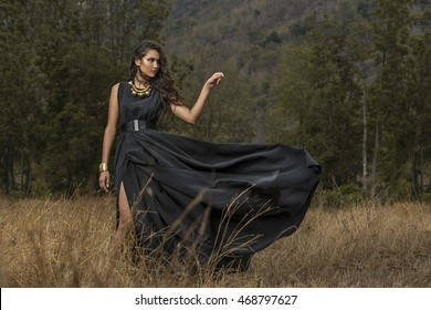 A full-body portrait of an attractive girl wearing black dress, fashion