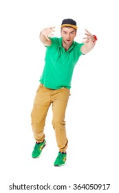 Fullbody portrait of young man b-boying in studio isolated on white.