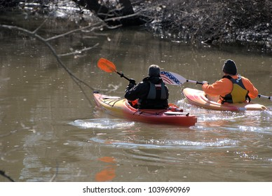 Fullersburg Woods, Oak Brook, IL USA, March 3, 2018. Two men kayak on Salt Creek