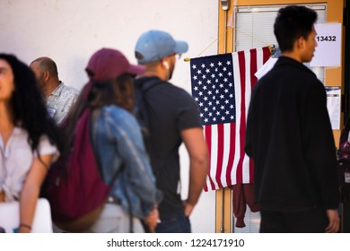 Fullerton, California / USA - November 6, 2018: Voters wait in line at a Fullerton polling place to vote in the 2018 Midterm Elections.