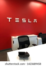 Fullerton, CA/USA - January 2019: View of Tesla sign at local Tesla dealership. Tesla is a manufacturer of electric cars in the United States