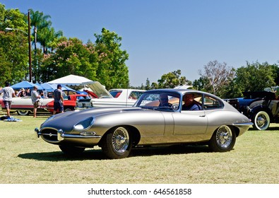 FULLERTON/CALIFORNIA - MAY 21, 2017: Classic XKE Jaguar leaving a gathering of like minded classic car enthusiasts who gathered in a park in Fullerton, California USA