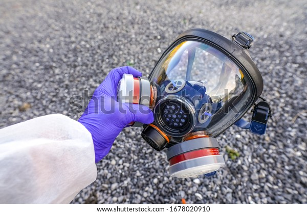 Full-Face Respirator protective gas mask  close up against virus, radiation, bacteria and dust. Professional mask shortage during Covid-19 Coronavirus SARS-CoV-2 pandemic worldwide outbreak.