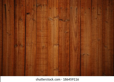 A full-frame wood fence background.
