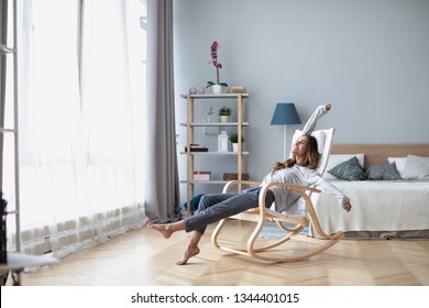 Full-length body gorgeous good-looking attractive pretty lady with her beaming smile she stretch oneself indoor cosy modern room. Good weekend.