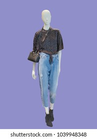 Full-length female mannequin dressed in blue jeans and, isolated. No brand names or copyright objects.