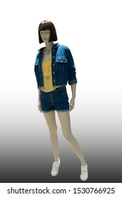 Full-length female mannequin dressed in blue jeans short suit, isolated. No brand names or copyright objects.