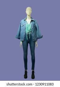 Full-length female mannequin dressed in jeans suit, isolated. No brand names or copyright objects.