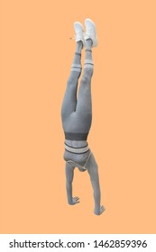 Full-length female mannequin dressed in sportswear, performing a handstand.  Isolated. No brand names or copyright objects.
