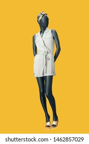Full-length female mannequin dressed in summer fashionable clothes, isolated. No brand names or copyright objects.