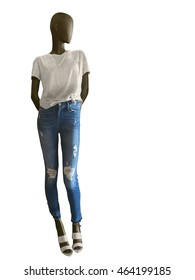 Full-length female mannequin dressed in t-shirt and blue jeans, isolated on white background. No brand names or copyright objects.