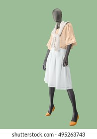 Full-length female mannequin dressed in 