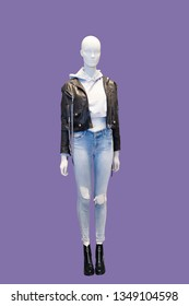 Full-length female mannequin wearing black leather jacket and blue jeans. Isolated. No brand names or copyright objects.