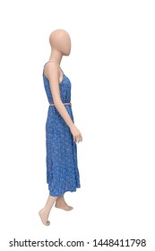 Full-length female mannequin wearing fashionable colorful dress, isolated on white background. No brand names or copyright objects.