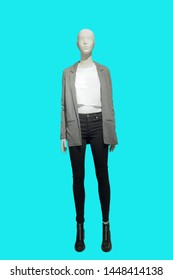 Full-length female mannequin wearing gray jacket and black jeans, isolated. No brand names or copyright objects.