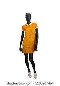 Full-length female mannequin wearing yellow dress. Isolated on white background. No brand names or copyright objects.