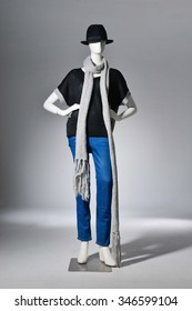full-length female with scarf in hat on mannequin -light background