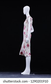 full-length full mannequin in flower pattern. sundress on black background