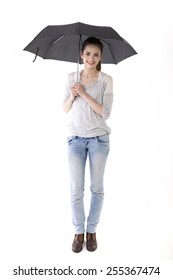 Full-length image of a Caucasian woman wearing casual clothes and standing under an umbrella. Isolated on White Background.