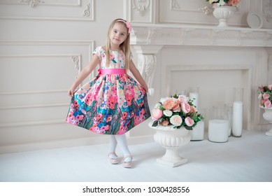 Full-length of little smiling girl child in colorful dress posing indoor. - Shutterstock ID 1030428556