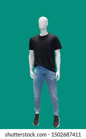 Full-length male mannequin dressed in casual summer clothes, isolated on green background. No brand names or copyright objects.