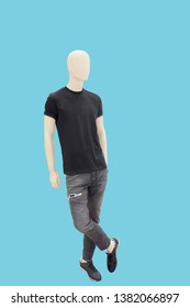 Full-length male mannequin dressed in summer casual clothes, isolated. No brand names or copyright objects.