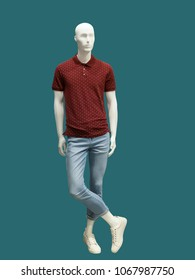 Full-length male mannequin dressed in t-shirt and jeans, isolated. No brand names or copyright objects.