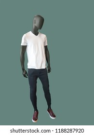 Full-length male mannequin dressed in white t- shirt and black jeans, isolated. No brand names or copyright objects.