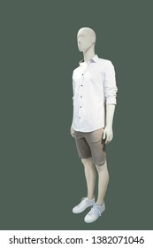 Full-length man mannequin dressed in casual clothes, isolated. No brand names or copyright objects.