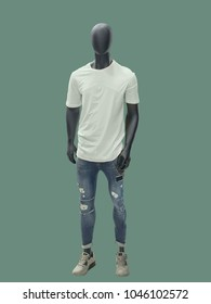 Full-length man mannequin dressed in summer casual clothes, isolated on green background. No brand names or copyright objects.