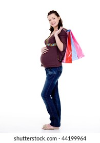 Full-length photo of a Beautiful cheerful pregnant woman with shopping bags