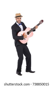 Full-length photo of excited artistic man playing his guitar in a formal suit. Isolated on white background.