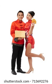 Full-length portrait of Asian young couple with gift and cards for Chinese New Year