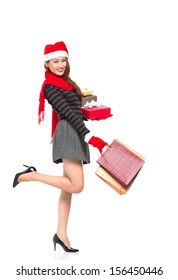 Full-length portrait of an attractive lady having x-mas shopping against a white background