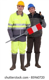 full-length portrait of bricklayer and carpenter