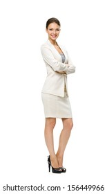 Full-length portrait of business woman with her hands crossed, isolated on white. Concept of leadership and success