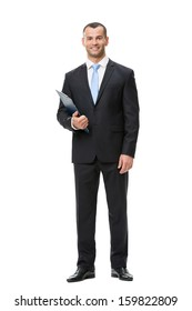 Full-length portrait of businessman handing folder, isolated on white. Concept of leadership and success