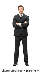 Full-length portrait of businessman with hands crossed, isolated on white. Concept of leadership and success
