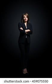 Full-length portrait of businesswoman  isolated on black background