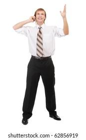 full-length portrait of happy businessman speaking over cellphone