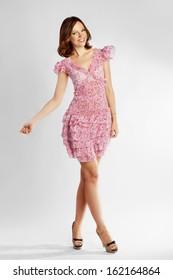 Full-length portrait of a lovely brunette woman in romantic dress