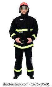 Full-length portrait of a man in black uniform of a fireman with a red helmet on a white isolated background. The model stands right in front of the camera. Studio photo.