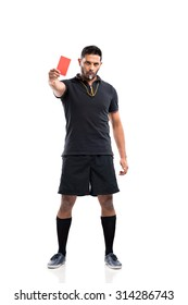 Full-length portrait of referee showing a red card