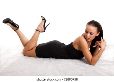 Full-length portrait of sexy young woman in black dress