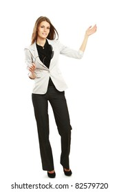A full-length portrait of a successful businesswoman