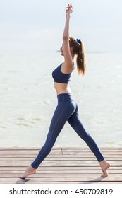 Full-length portrait of woman in fitness wear near the sea